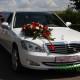 Лімузин білий з чорним дахом та екібаною на весілля